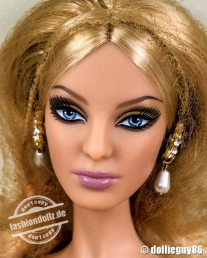 2010 Glimmer of Gold Barbie R4495 by Robert Best